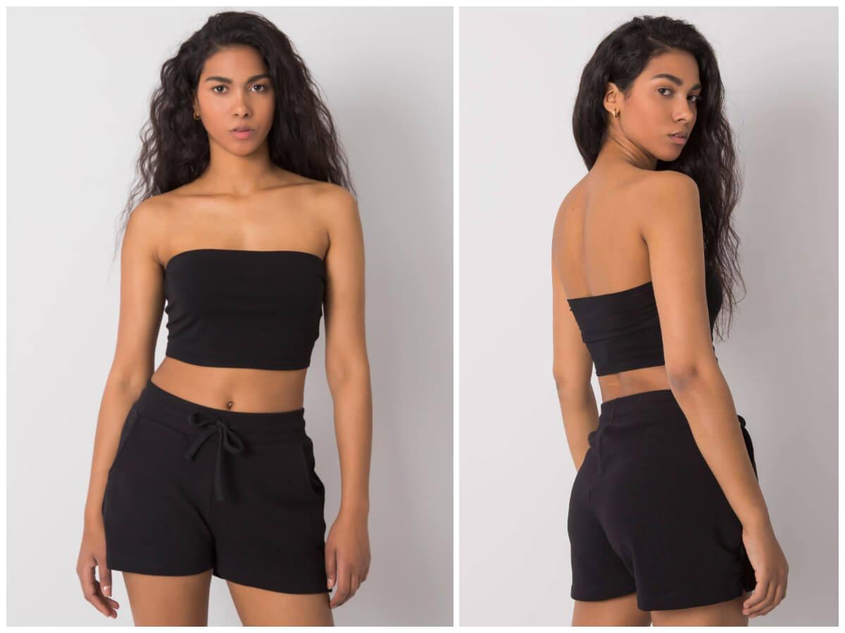 Modelka prezentuje stylizację basic złożoną z topu bez ramiączek oraz dresowych szortów